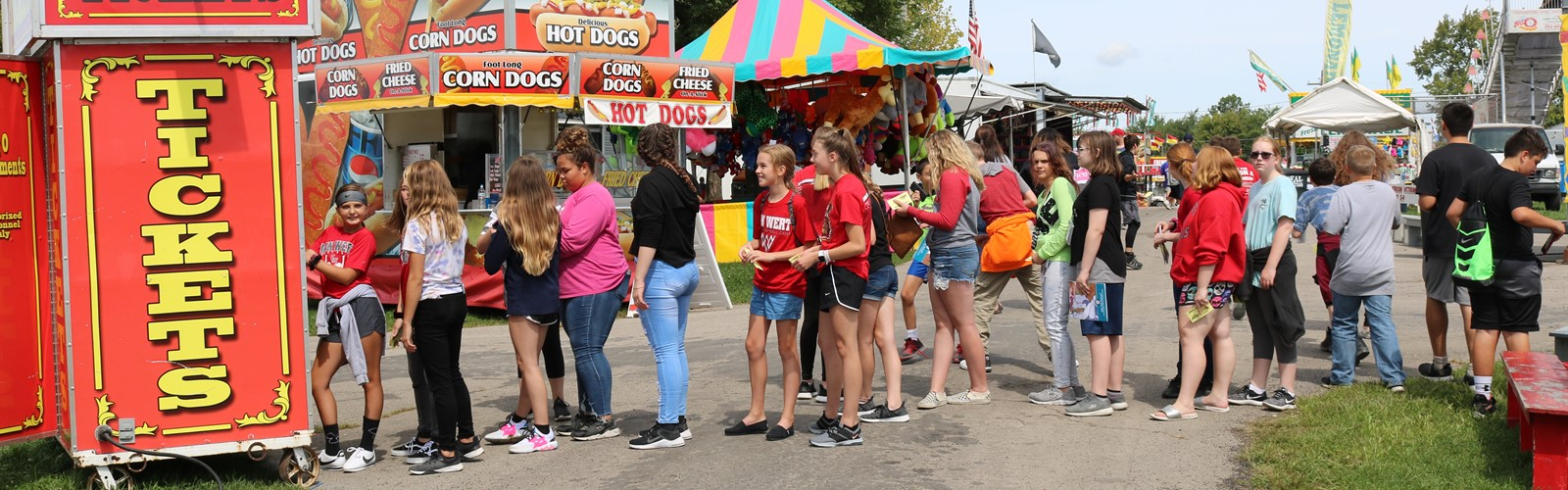 7th grade students wait to purchase tickets at the fair
